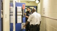 Special Inspector Raj Chahal and a colleague deal with the prisoner